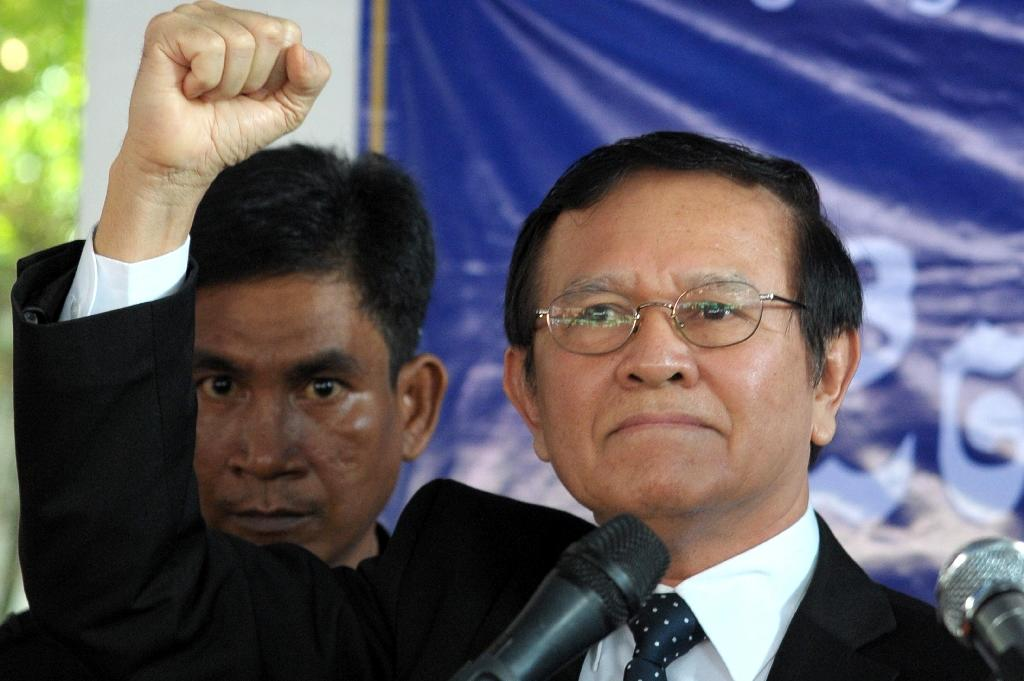 Cambodian opposition party deputy leader Kem Sokha (R) delivers a speech at the Cambodia National Rescue Party (CNRP) headquarters in Phnom Penh, on September 9, 2016
