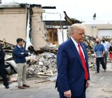 The owner of a destroyed shop in Kenosha refused to pose with Trump – so they brought in the old owner
