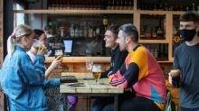 'I couldn't wait': beer flows again in England's pubs