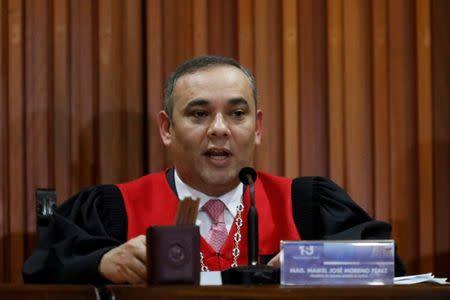 Venezuela's Supreme Court President Maikel Moreno reads a statement in Caracas