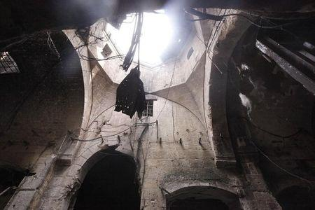 A damaged ceiling is pictured in Bab Antakya district in Old Aleppo