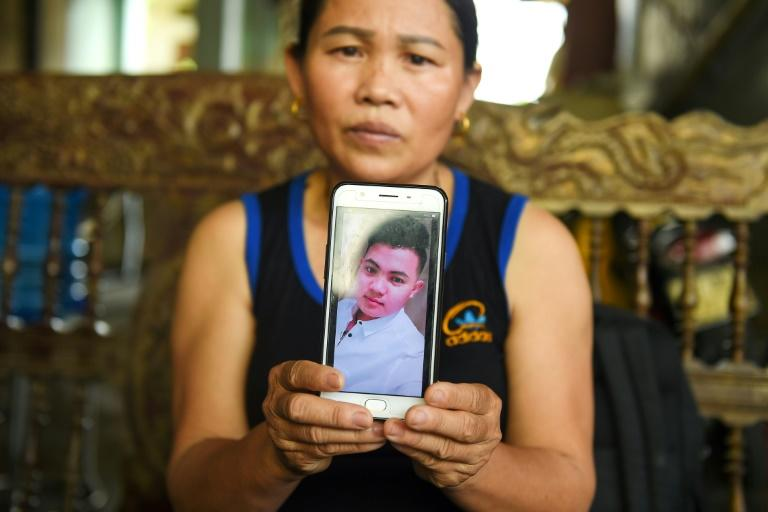 Hoang Van Tiep, pictured on the screen, is feared to be among the 39 people found dead in a truck in Britain (AFP Photo/Nhac NGUYEN)