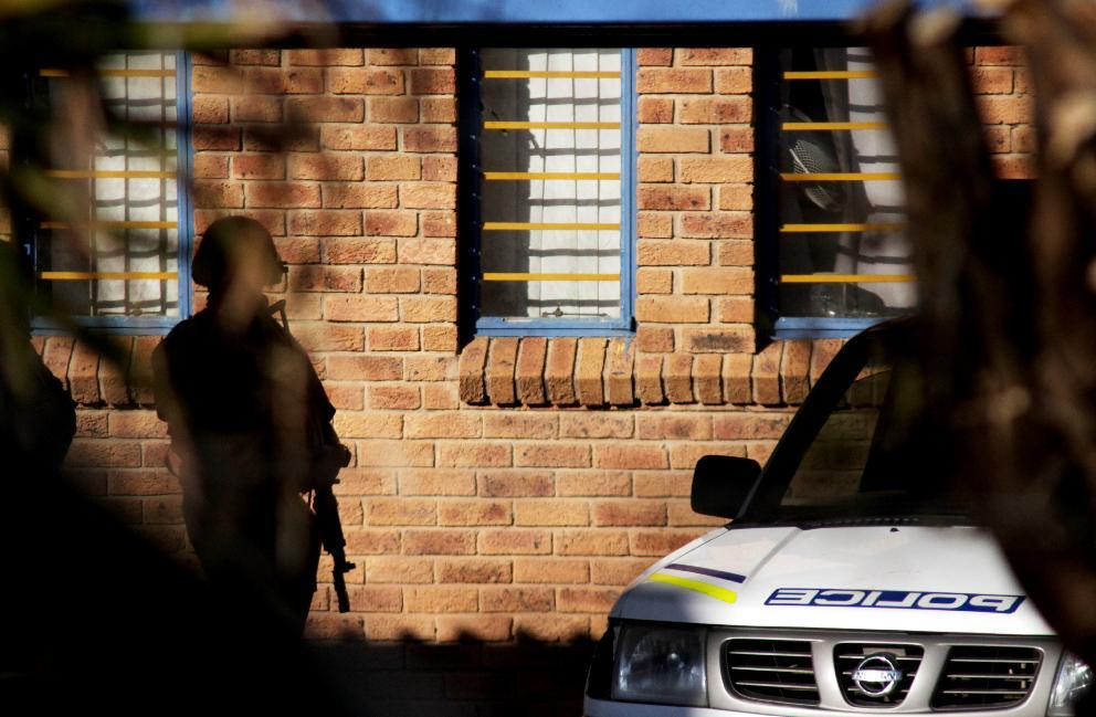 A South African Police service van and a member of security are seen outside the Lesotho Mounted Police headquarters on September 3, 2014 in Maseru (AFP Photo/Hlompho Letsielo)