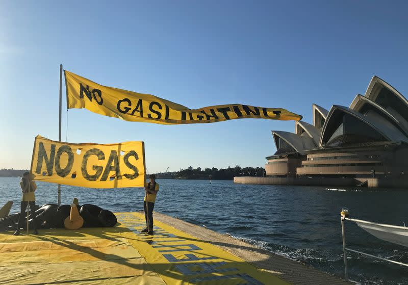 Ambrose Hayes, a 15-year-old climate change activist, rides on a barge during an event as part of the Fund Our Future Not Gas climate rally in Sydney Harbour