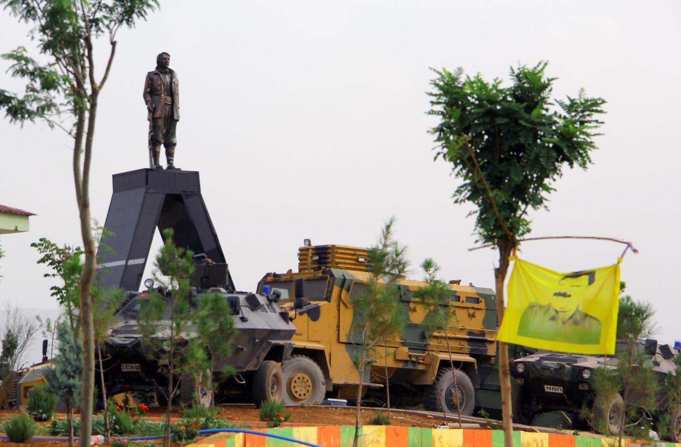 Turkish armoured vehicles surround a statue of Mahsum Korkmaz -- one of the founders of the outlawed Kurdistan Workers' Party (PKK) -- as they tighten security in Diyarbakir, on August 19, 2014