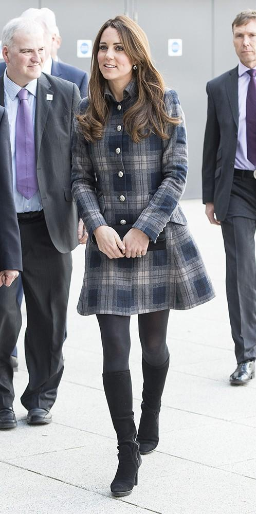 During a visit to Scotland,Kate and Wills met well wishers, played some ping pong, field hockey and basketball while she wore this tartan coat by British brandmoloh.