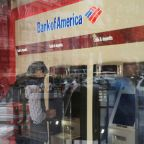 Bank of America takes tax hit, vows longer-term boost