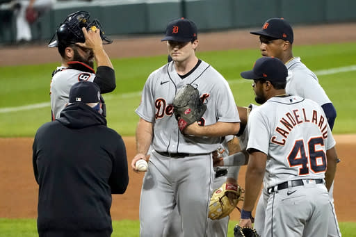 Detroit Tigers manager Ron Gardenhire, front left, comes to the mound to relieve starting pitcher Casey Mize during the sixth inning of a baseball game against the Chicago White Sox, Friday, Sept. 11, 2020, in Chicago. (AP Photo/Charles Rex Arbogast)