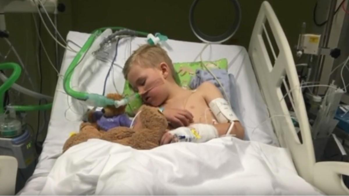 Mother shares photo of son, 8, in intensive care with flu to warn parents about dangers of common virus