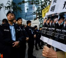 Hong Kong police jailed over attack on democracy protester