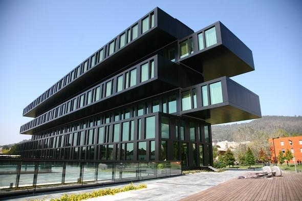 """<p> Situated in the folkloric village of Viana do Castelo, the Axis Viana Business & SPA Hotel has a contemporary exterior made up of reflective aluminium, green stone and black glass. The building has overlapping stacked levels providing different perspectives, ranging from a full box frontal view and a complex column side view. In contrast to the exterior, the hotel's interior features white finishes, wood and stone. There are 88 rooms, a modern outdoor pool, an extensive spa with a Turkish bath, two swimming pools and a variety of massage treatments, plus fantastic views of the Lima River and the Mount St Luzia. Visit <a href=""""http://www.axishoteis.com/"""" target=""""_blank"""">axishoteis.com</a></p>"""