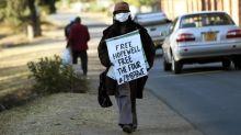 Zimbabwe police arrest opposition member and journalist