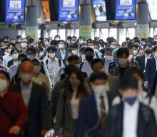 Japan set to extend virus emergency in Tokyo through May 31