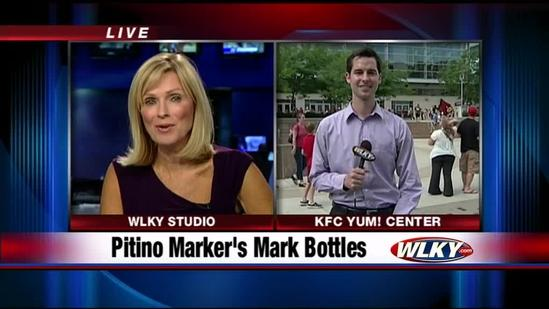 Cards fans line up to get Maker's Mark bottles signed by Rick Pitino