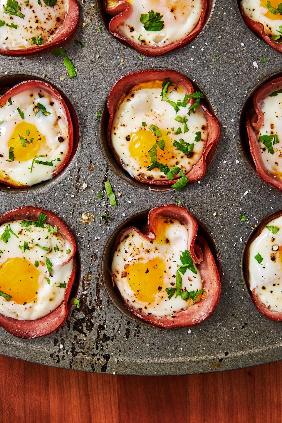 "<p>Breakfast in a bite!</p><p>Get the recipe from <a href=""https://www.delish.com/cooking/recipe-ideas/recipes/a50901/ham-cheese-egg-cups-recipe/"" rel=""nofollow noopener"" target=""_blank"" data-ylk=""slk:Delish"" class=""link rapid-noclick-resp"">Delish</a>.</p>"