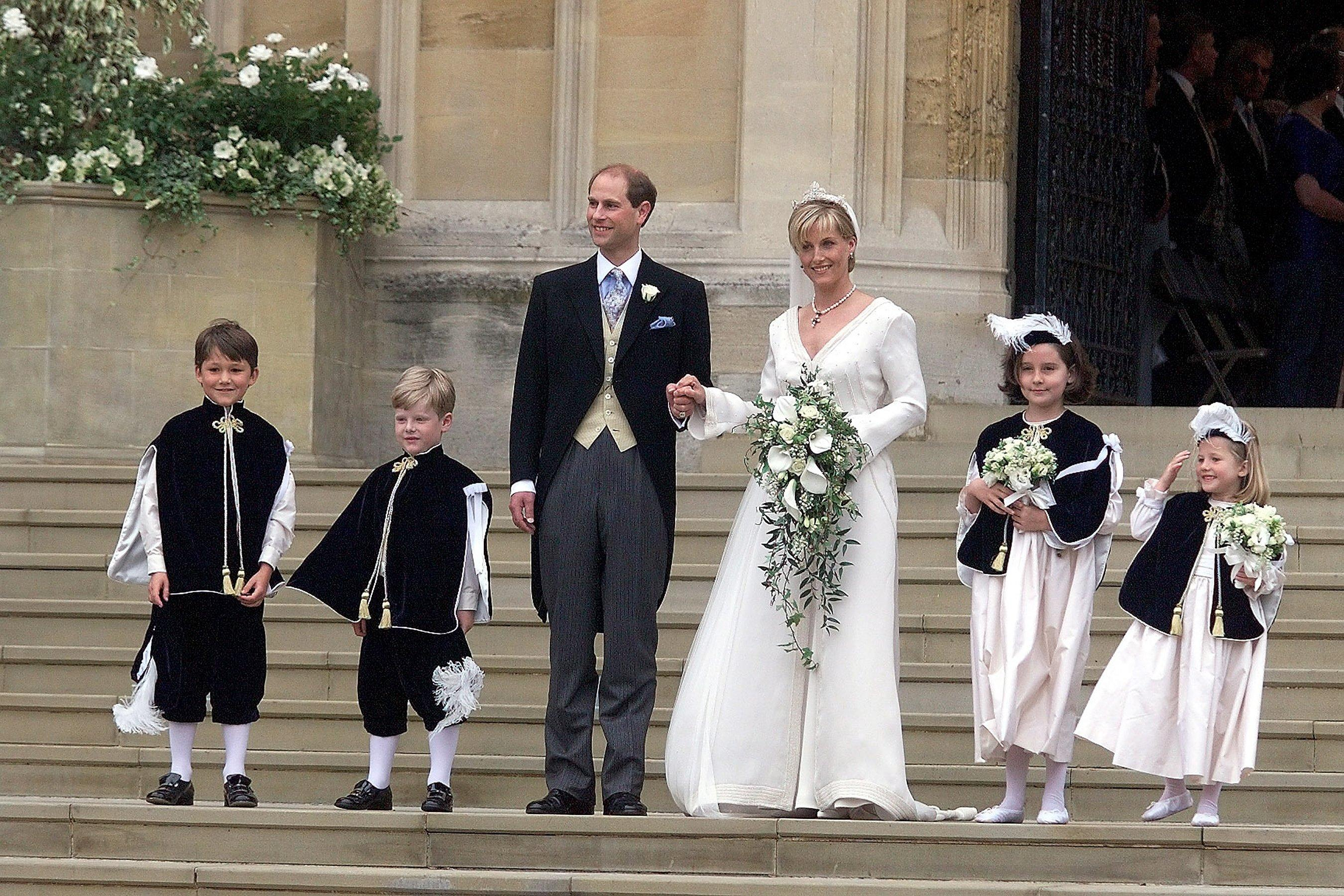 The bride wore an ivory silk organza wedding dress designed by Samantha Shaw along with a crystal beaded veil. For her tiara, Sophie wore a previously unseen piece from the Crown Jewel collection made up of four detachable diamond anthemions believed to have been taken from one of Queen Victoria's famous crowns.