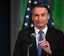 Brazil leader, wooing Trump, opens base to US rockets