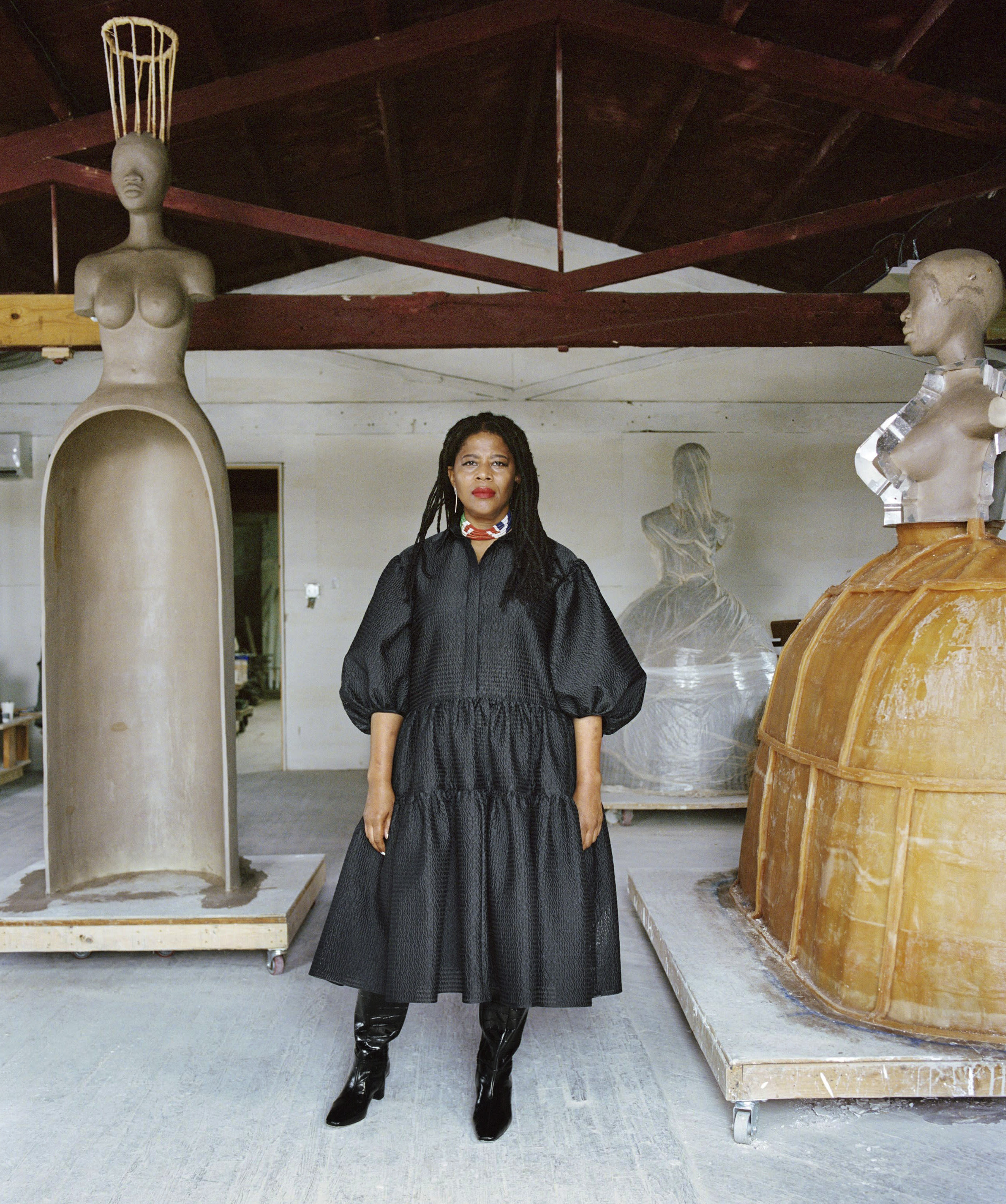 In this 2020 photo provided by Boston's Institute of Contemporary Art, artist Simone Leigh poses for a photo at Stratton Sculpture Studios in Philadelphia. Leigh will be the first Black woman ever to represent the U.S. at Italy's prestigious Venice Biennale arts festival to be held in 2022. (Shaniqwa Jarvis/Simone Leigh and Hauser & Wirth via AP)