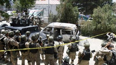 Taliban storm Afghan hotel in deadly attack