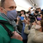 Putin critic Alexei Navalny detained upon return to Moscow after poisoning allegedly linked to Kremlin