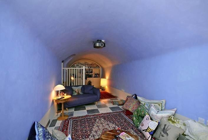 <p>The basement has been transformed into a cosy screening room with under-floor heating.</p>  <p></p>