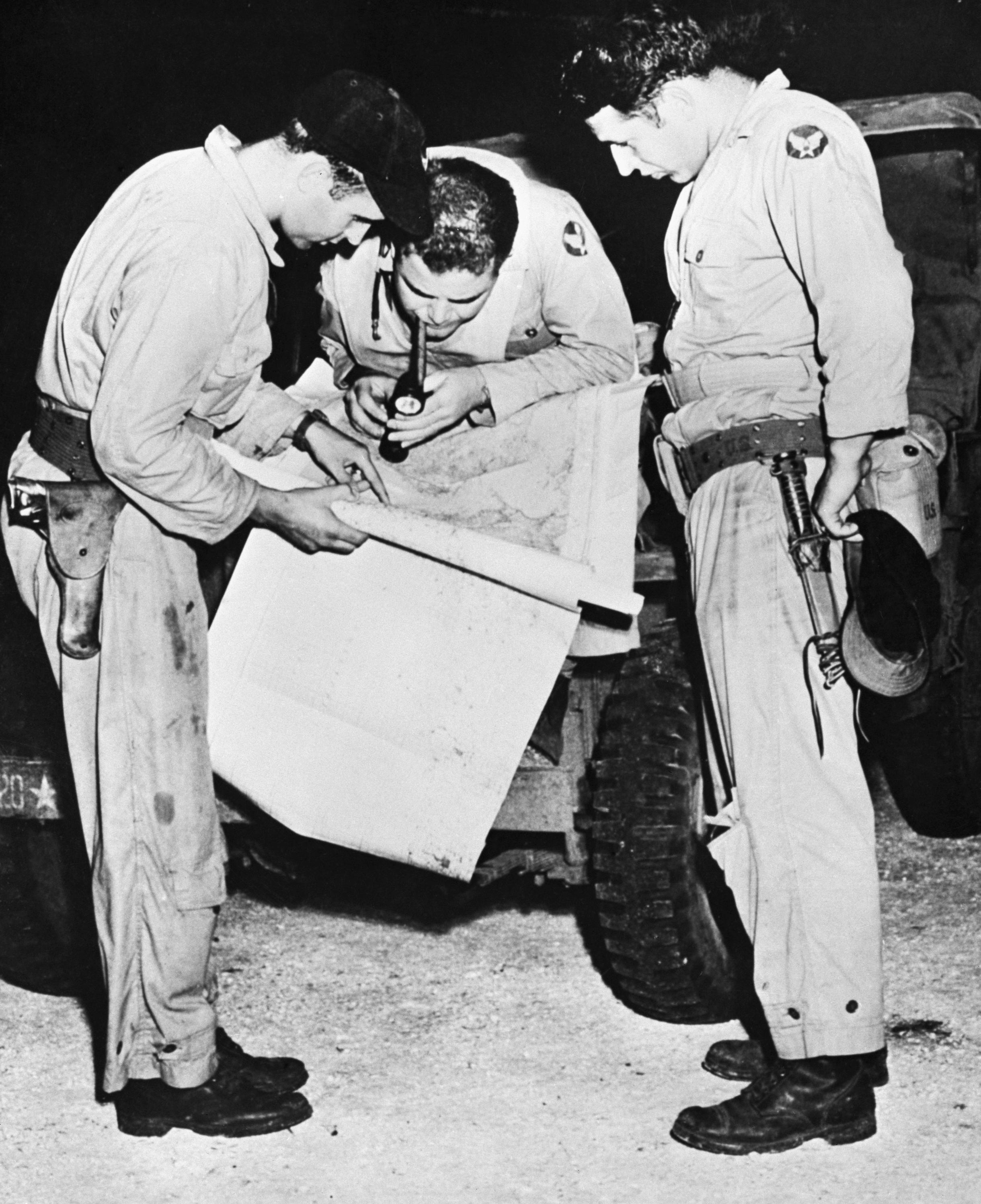 """<p>Men who helped drop the second war-stopping atomic bomb on Nagasaki, Japan, study a map of their objective shortly before the take off of the B-29 """"77"""" which dropped the bomb on Aug. 9, 1945. Left to right: Capt. Theo J. Van Kirk, navigator, who also made flight aboard the 'Enola Gay' when it dropped the first atom bomb on Hiroshima; Major Sweeney, commanding officer of the 393 bomb squadron and pilot. (Photo: Bettmann/Getty Images) </p>"""