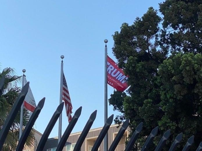 "Ian Thomas Malone tweeted a photo of the ""Trump"" flag that briefly flew at Long Beach Police Headquarters Saturday, Oct. 3."
