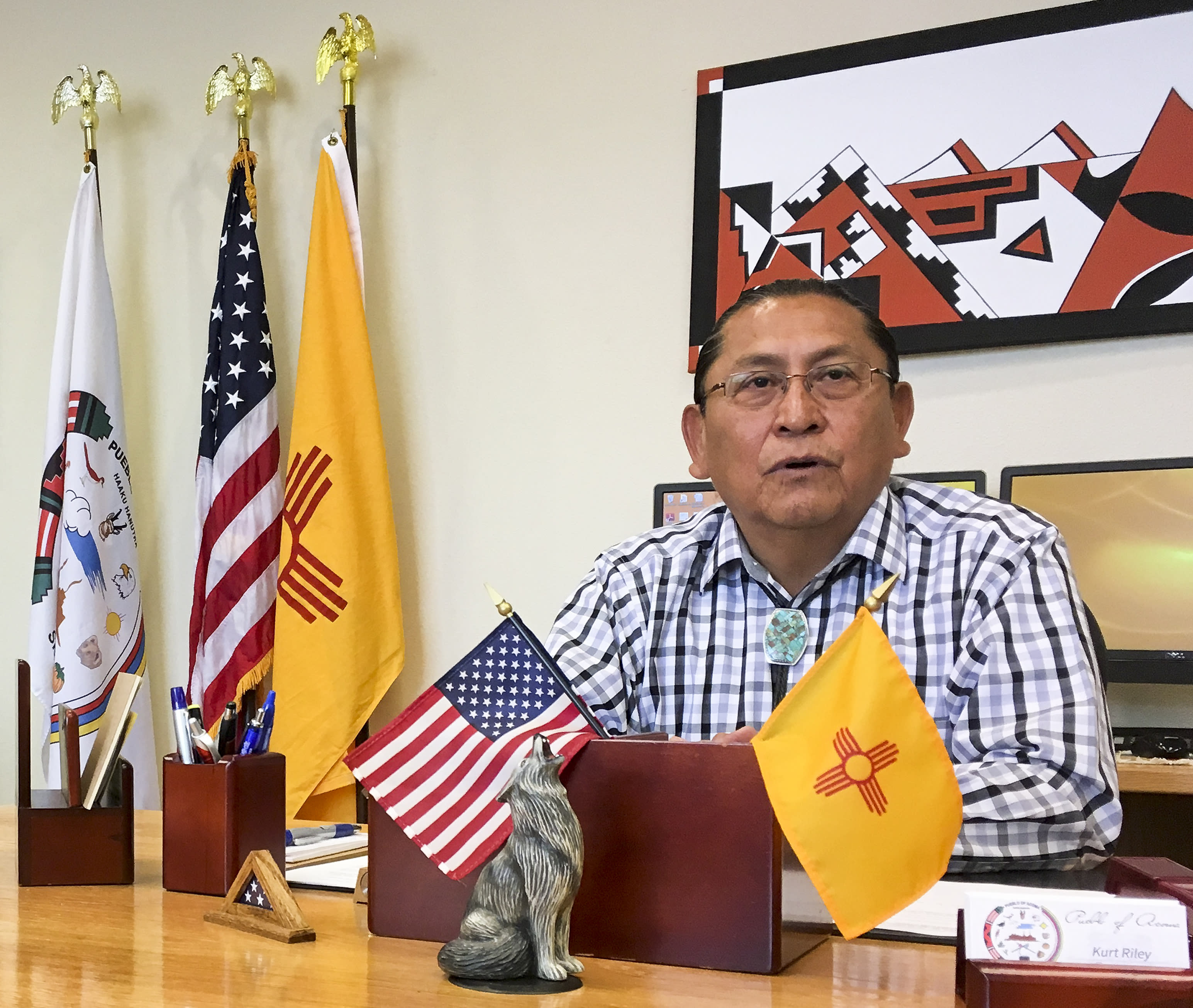 FILE - In this June 8, 2016, photo, Gov. Kurt Riley, of Acoma Pueblo, discusses his tribe's move to repatriate a ceremonial shield from Paris, France, during an interview in Acoma Pueblo, N.M. A ceremonial shield has been returned to New Mexico more than three years after it became central to an international debate over the export of Native American items. U.S. and Acoma Pueblo officials planned Monday, Nov. 18, 2019, to announce the shield's return from Paris, where it had been listed for bidding in 2016 before the EVE auction house took the rare step of halting its sale. (AP Photo/Mary Hudetz, File)