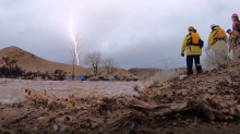 Lightning Strikes as Rescue Crew Pull Woman From Surging Creek