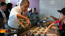 President's reach over Chipotle's sneeze guard sparks discussion