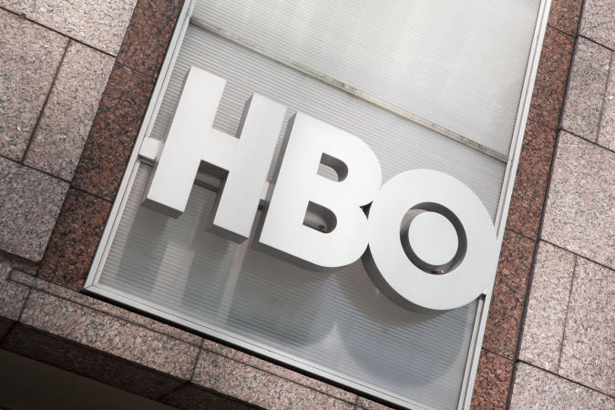 Manhattan, New York USA - July 9, 2011: HBO logo on the HBO Building in New York City, across the street from Bryant Park. HBO is a premium cable specialty channel and is owned by Time Warner.