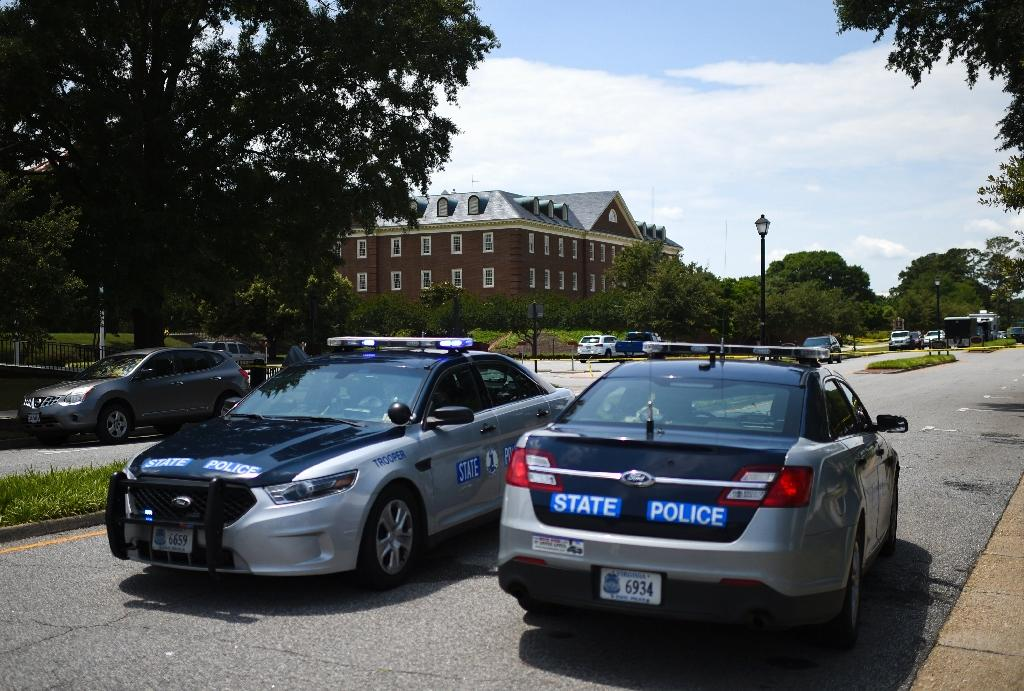 Police cars are seen near Building No 2 at the Virginia Beach Municipal Center, the scene of a mass shooting that left 12 dead (AFP Photo/Eric BARADAT )