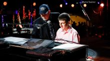 Billy Joel plays piano with blind fan before concert in New York City