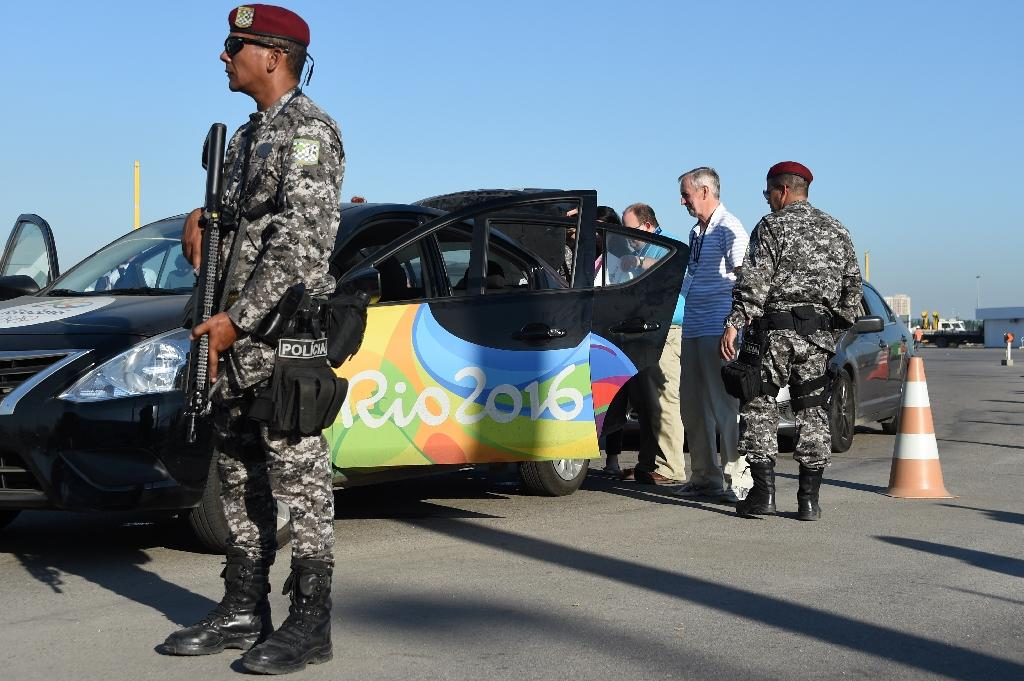 Police man a checkpoint at the Olympic Village in Rio de Janeiro, Brazil on July 5, 2016 during a security handover ceremony