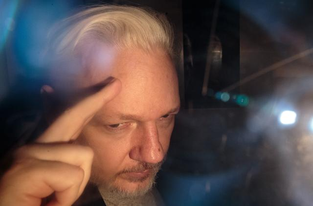 DOJ accuses WikiLeaks founder Julian Assange of recruiting hackers
