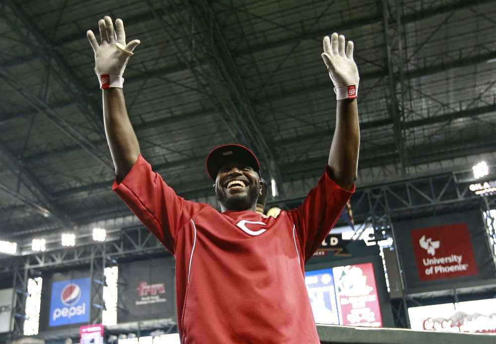 Cincinnati Reds' Brandon Phillips waves to fans before a baseball game against the Arizona Diamondbacks, Saturday, May 31, 2014, in Phoenix