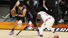Devin Booker 'feels better' after bloody collision, may need to wear mask over injured nose