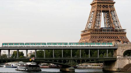 FILE PHOTO: An elevated Paris Metro passes over a bridge next to the Eiffel Tower in Paris