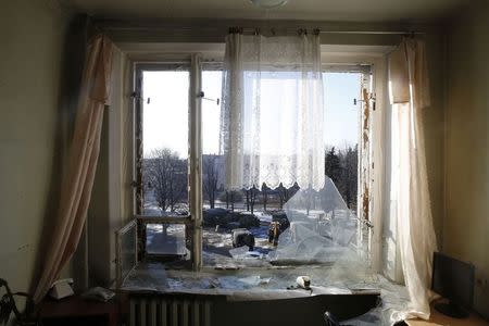 Vehicles in the service of the separatist self-proclaimed Donetsk People's Republic army are seen through broken windows in the city of Debaltseve, February 20, 2015. REUTERS/Baz Ratner