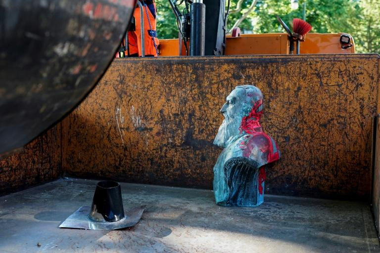 A bust of Leopold II was daubed with red paint and removed in Auderghem, near Brussels (AFP Photo/kenzo tribouillard)
