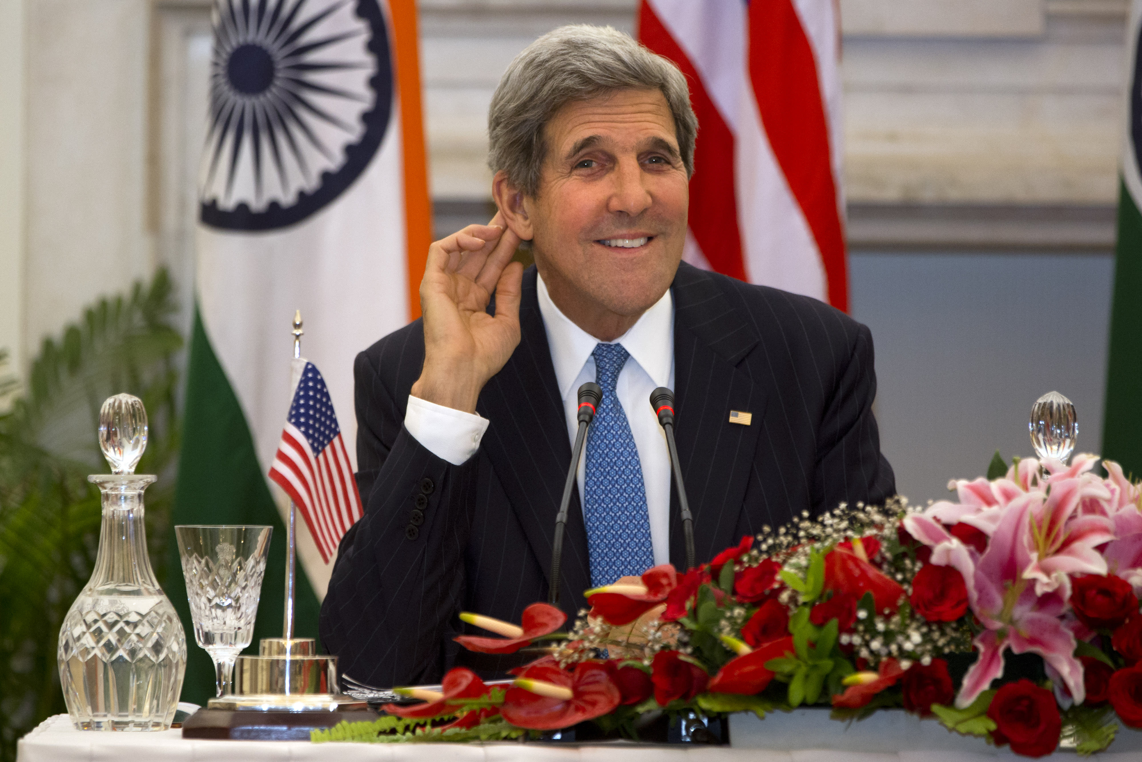 U.S. Secretary of State John Kerry smiles as he asks a reporter to repeat a question during a news conference with Indian Foreign Minister Salman Khurshid, not pictured, at Hyderabad House in New Delhi, India on Monday, June 24, 2013, during Kerry's first visit to India as secretary. (AP Photo/Jacquelyn Martin, Pool)
