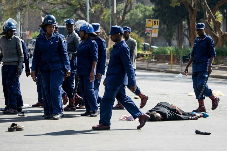 Police violently dispersed protesters in Harare who defied a ban on demonstrations on Friday. (AFP Photo/Zinyange Auntony)