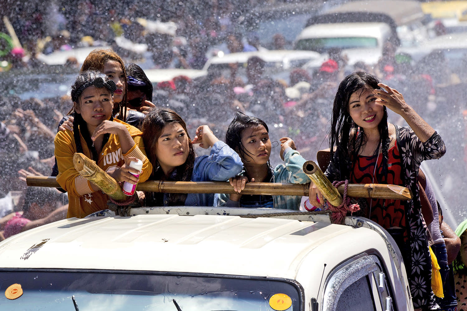 <p>Revelers are sprayed with water as they ride in the back of a truck during the second day of the traditional water festival, which is also known as the Burmese New Year Festival of Thingyan, April.14, 2017, in Yangon, Myanmar. (Photo: Thein Zaw/AP) </p>