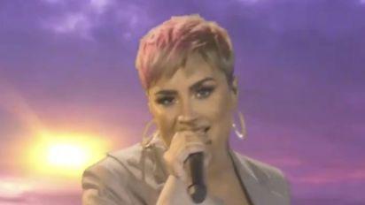 Lovato slams 'unrealistic beauty expectations'