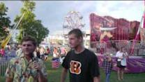 Prankster Conducts Interviews at the Fair