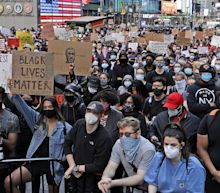 In New York, peaceful daytime protests give way to chaos as night falls