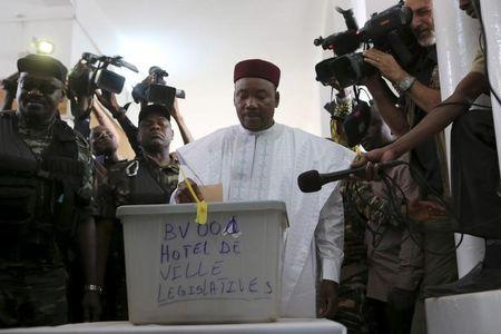 Niger's incumbent President Mahamadou Issoufou votes at a polling station during the country's presidential and legislative elections in Niamey