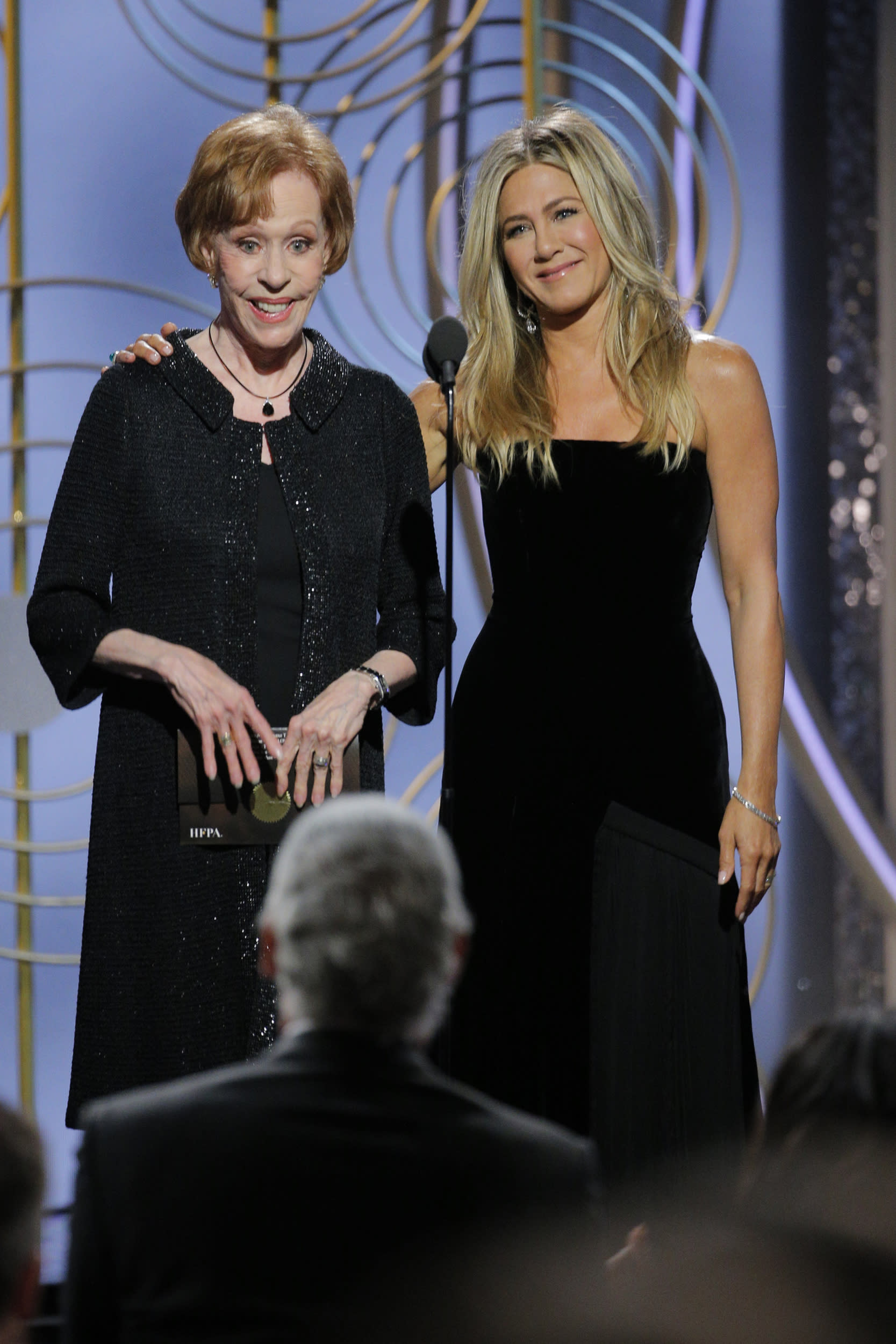 BEVERLY HILLS, CA - JANUARY 07:  In this handout photo provided by NBCUniversal,  Presenters Carol Burnett and Jennifer Aniston onstage during the 75th Annual Golden Globe Awards at The Beverly Hilton Hotel on January 7, 2018 in Beverly Hills, California.  (Photo by Paul Drinkwater/NBCUniversal via Getty Images)