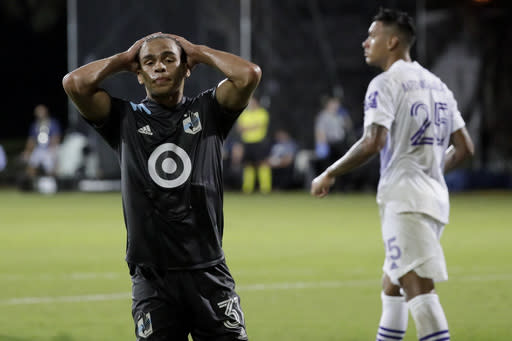 Minnesota United midfielder Hassani Dotson reacts after missing a shot on goal against Orlando City during the second half of an MLS soccer match, Thursday, Aug. 6, 2020, in Kissimmee, Fla. (AP Photo/John Raoux)