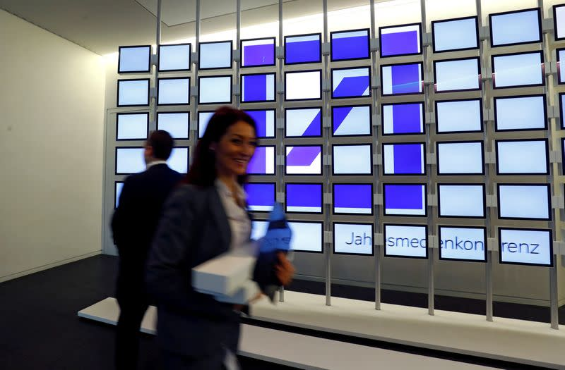 FILE PHOTO: Logo of Deutsche Bank AG is displayed during the bank's annual news conference in Frankfurt